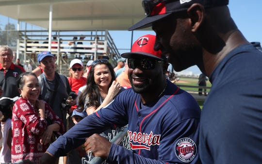 Riverdale High School graduate and current Minnesota Twins first base coach Tommy Watkins, left, meets with fans along with special assistant Latroy Hawkins on the first day of full squad workouts at Century Link Sports Complex Monday 2/18/2019. He has been in the Twins system for years and is coaching in the big leagues for the first time this year.