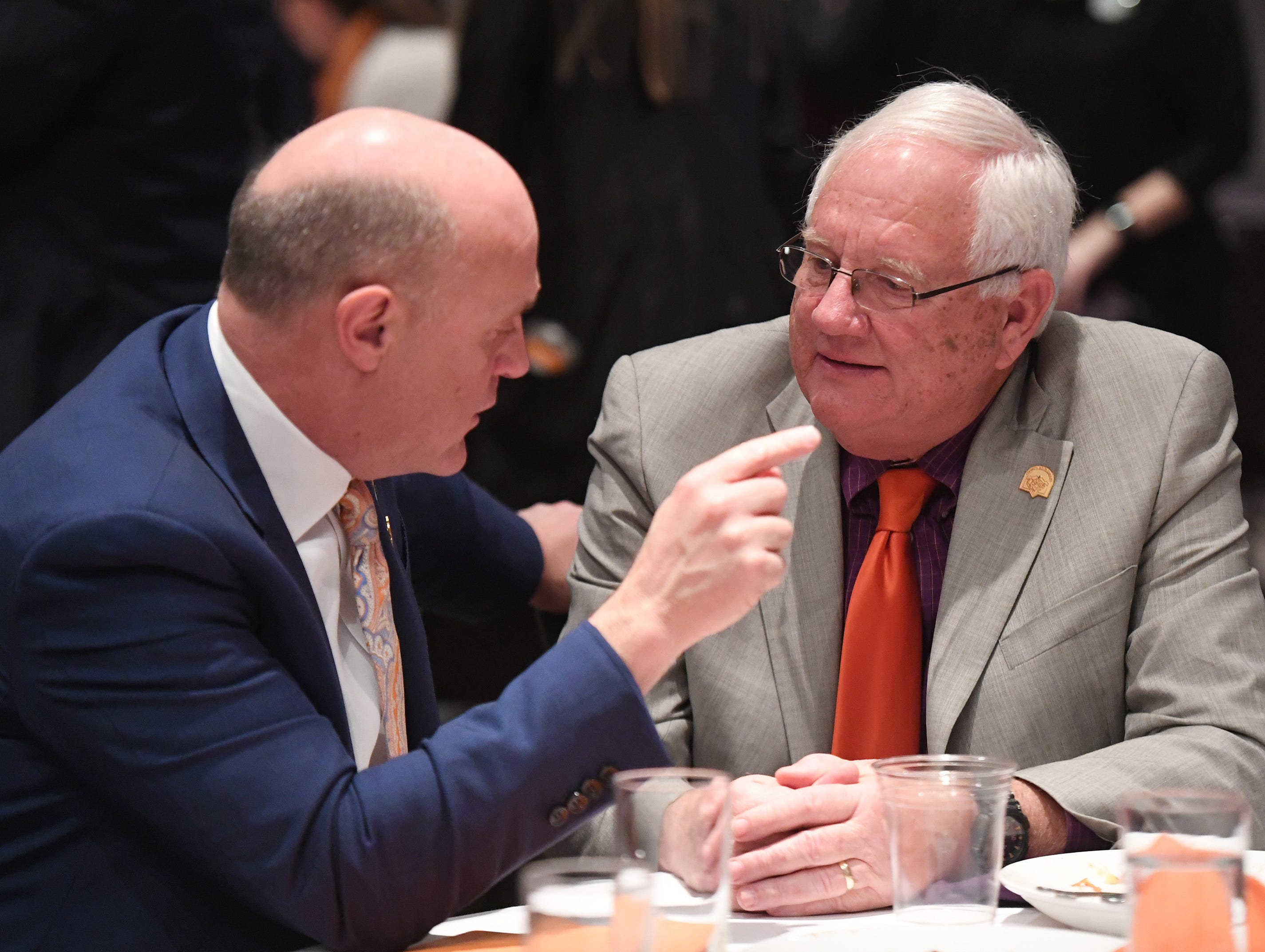 Clemson University President James Clements talks with City of Clemson Mayor J.C. Cook, at the end of the State of Clemson event held at the Madren Center Tuesday, Feb. 19, 2019.