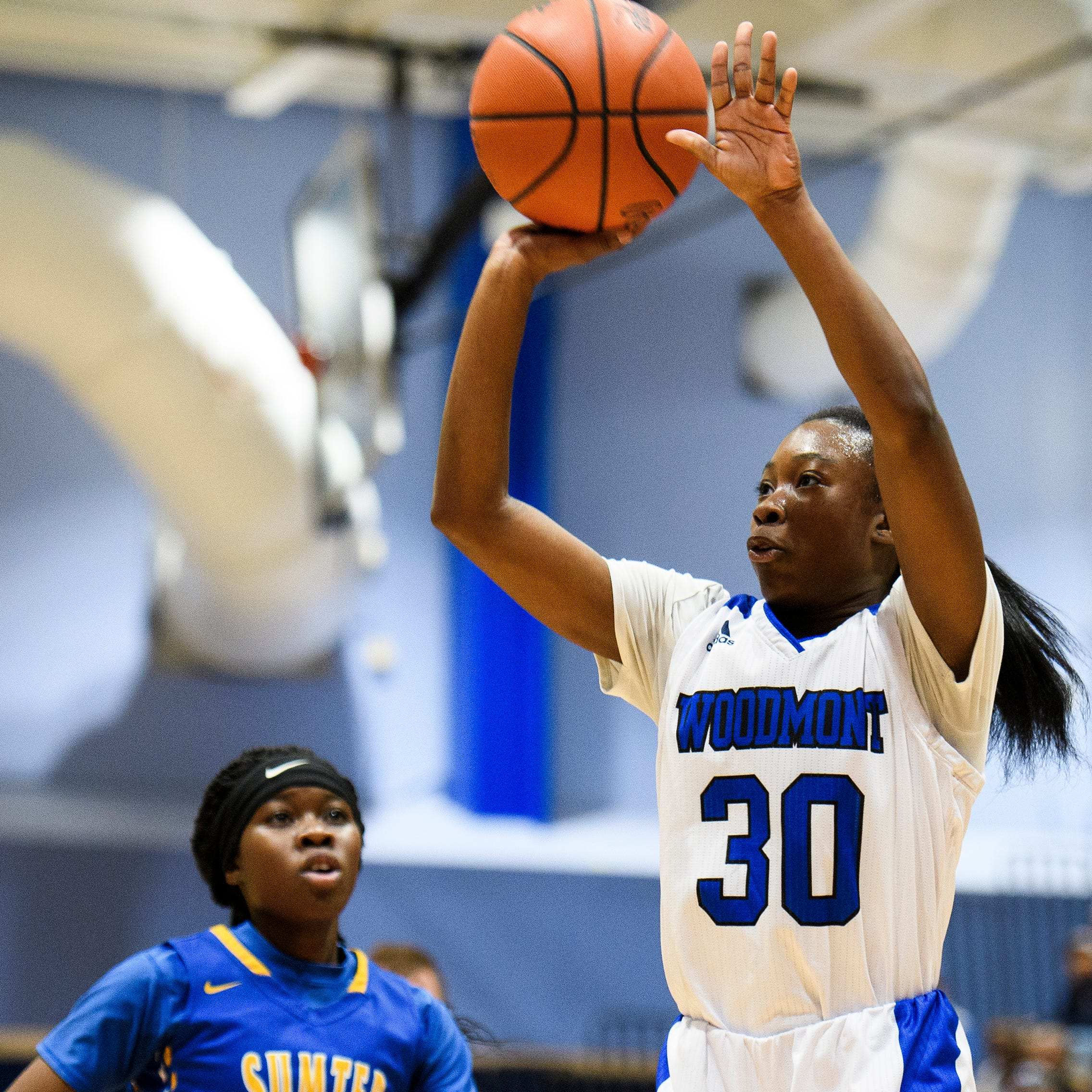 Woodmont's JaRae Smith (30) attempts to shoot the ball during their game against Sumter on Monday, Feb. 18, 2019.