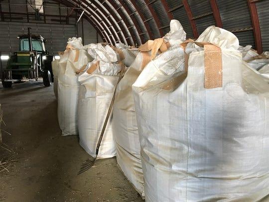 Bags of hemp await shipping on a farm near Choteau.