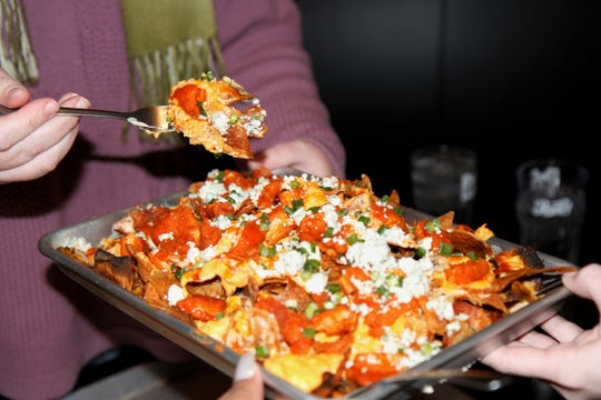 "If this is the shareable size of ""Buffalo Chicken Nachos,"" imagine the party size"
