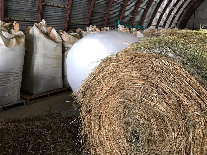 Bales of hemp await processing.