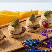 Buttermilk biscuits and andouille sausage give an authentic start to a New Orleans meal for those wanting to whip up a Mardi Gras meal like you'd have in the Big Easy.