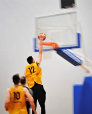 Pro Russian basketball player No. 12 Semen Shashkov of Vostok-65 flushes one during practice Feb. 17 at the Guam Basketball Confederation's training center.