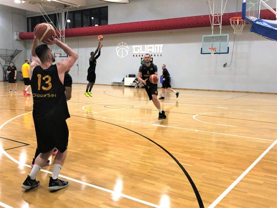 Members of the professional basketball team Vostok-65 of the Russian Superleague 1, work out at the Guam Basketball Confederation training center on Feb. 17.