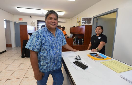 Guam Football Association President Tino San Gil, Jill Espiritu, media and marketing officer, right, and staff members at the GFA National Training Center offices in Dededo on Feb. 19, 2019.