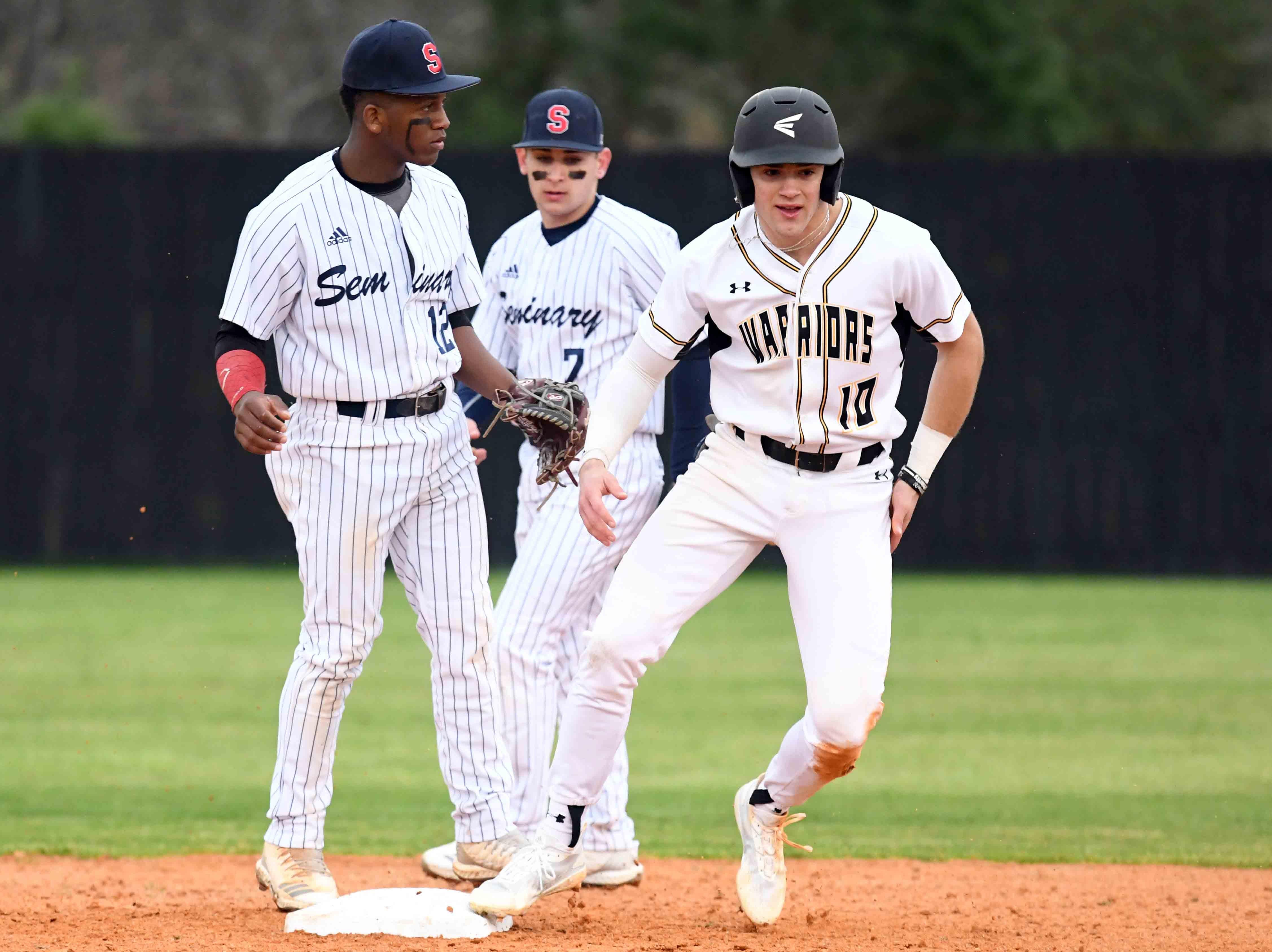 Oak Grove senior John Rhys Plumlee makes it to second base in their season opener against Seminary in Hattiesburg on Monday, February 18, 2019.