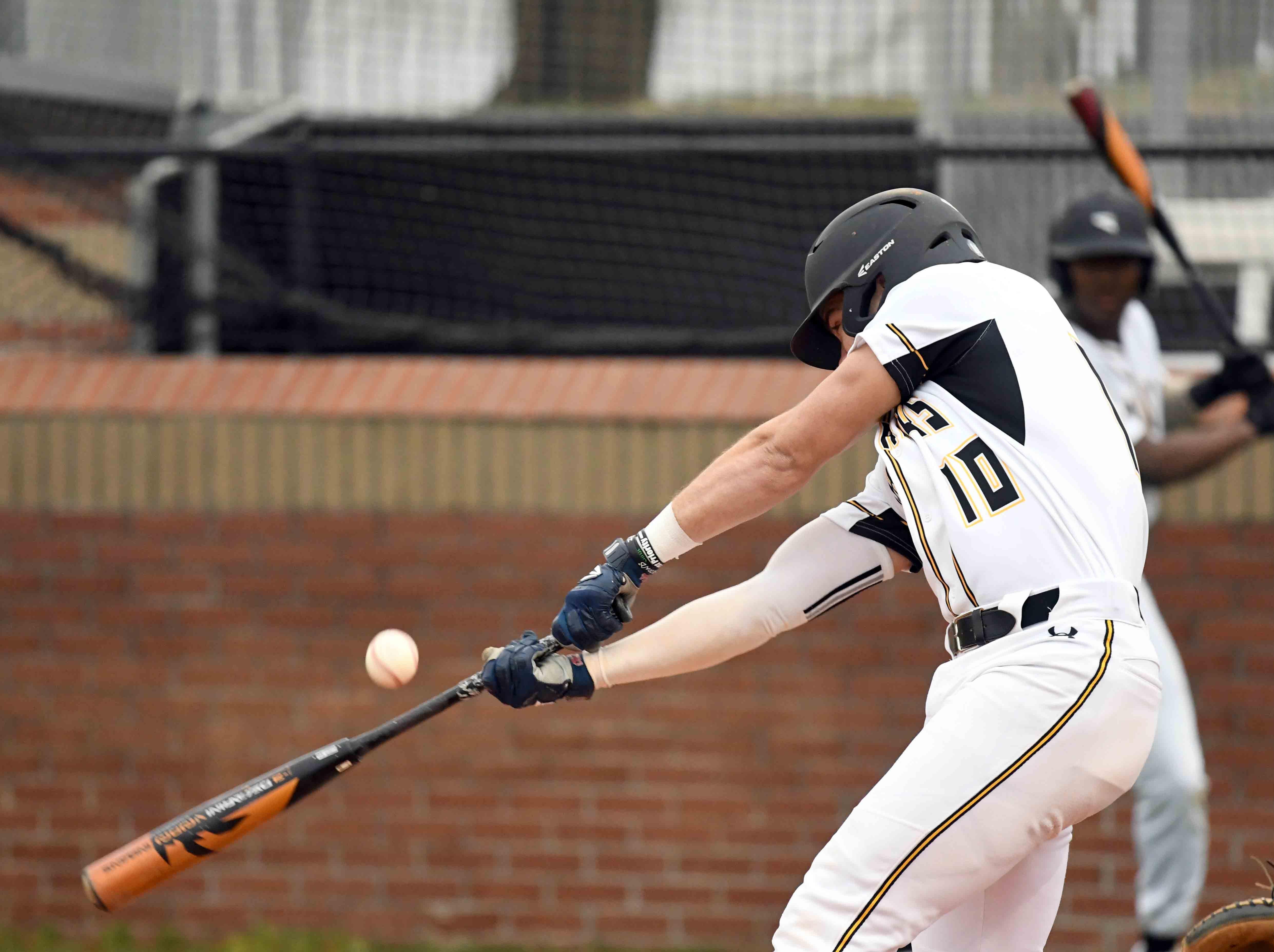 Oak Grove senior John Rhys Plumlee bats at home plate in their season opener against Seminary in Hattiesburg on Monday, February 18, 2019.