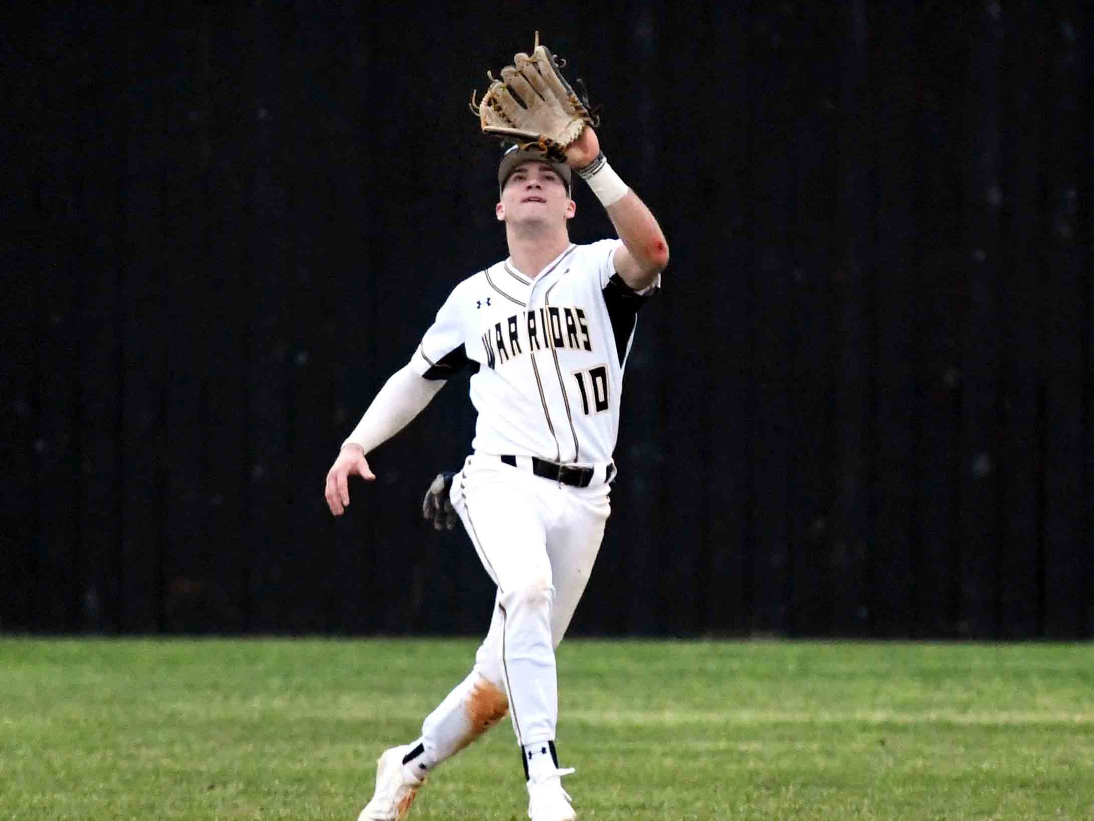 Oak Grove senior John Rhys Plumlee catches the ball in outfield in their season opener against Seminary in Hattiesburg on Monday, February 18, 2019.