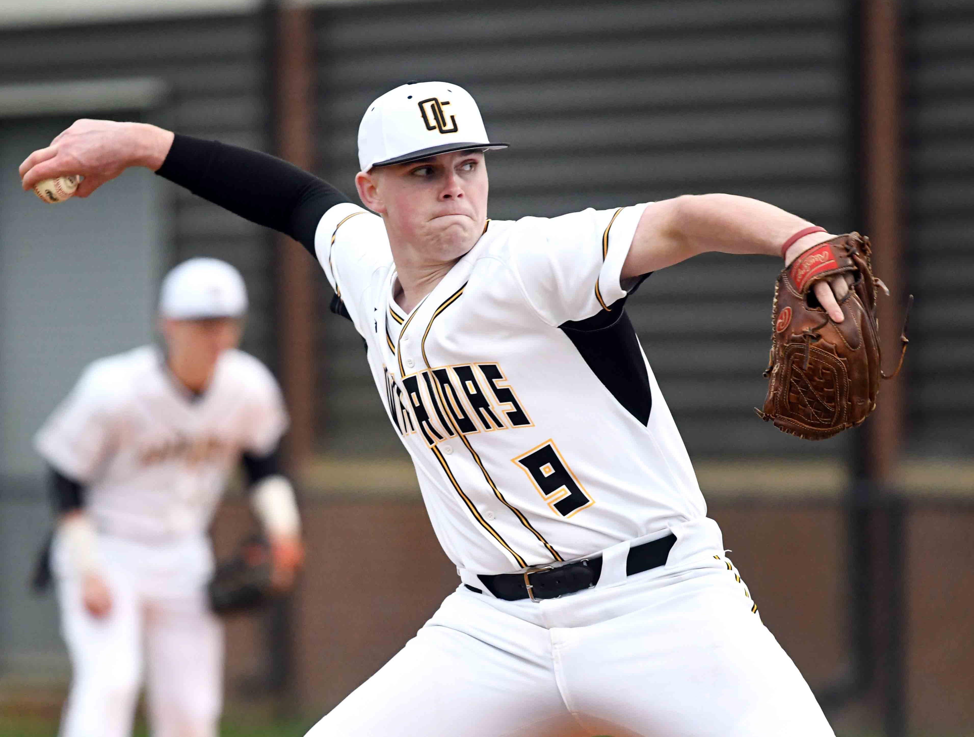 Oak Grove junior Luke Lyon pitches in their season opener against Seminary in Hattiesburg on Monday, February 18, 2019.