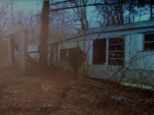 A dilapidated mobile home sits on the property used for Terror on the Trail in this slide from Monday night's zoning meeting.