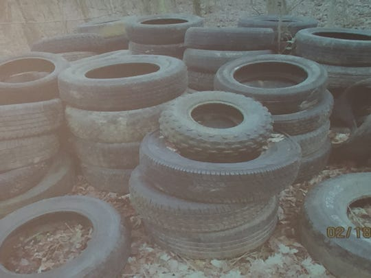 A pile of old tires sits outside on the property used for Terror on the Trail.