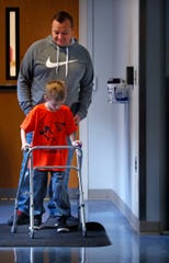 Josh Mills helps his 5-year-old son Brysen recover from a rare illness tied to the flu.
