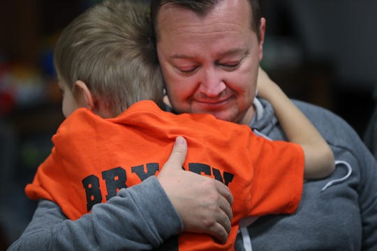Brysen hugs his father, Josh.