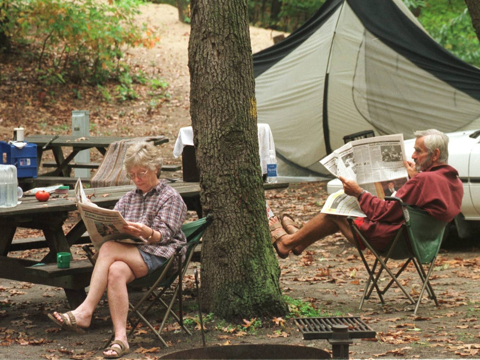 Irene and Cal Couch of Fort Wayne have been coming to the Indiana Dunes State Park to camp for years. On this morning they sit reading newspapers, while waiting for their camping gear to dry out from a soaking morning rain.