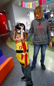 Lesley Mills watches her son Brysen at Riley Hospital for Children.