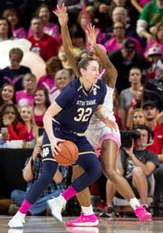 Notre Dame's Jessica Shepard (32) works in the post against North Carolina State's DD Rogers, right, during the first half of an NCAA college basketball game in Raleigh, N.C., Monday, Feb. 18, 2019.