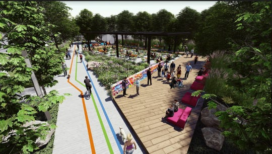 A Nickel Plate Trail rendering shows the planned downtown cultural commons in Fishers which would feature a small wooden outdoor performance stage, seating and hammock zone for relaxation near the Fishers Library.