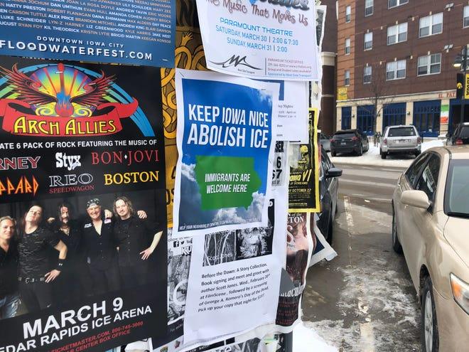 """A flier reads, """"Keep Iowa Nice Abolish ICE,"""" on Iowa Avenue in downtown Iowa City on Tuesday, Feb. 19, 2019."""