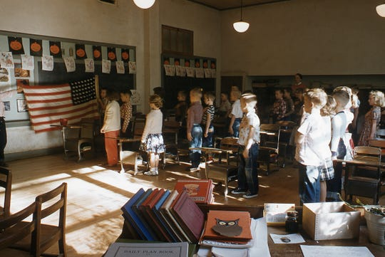 Second-grade students stand for the Pledge of Allegiance at the all-white Durant elementary school in Mississippi in 1955.