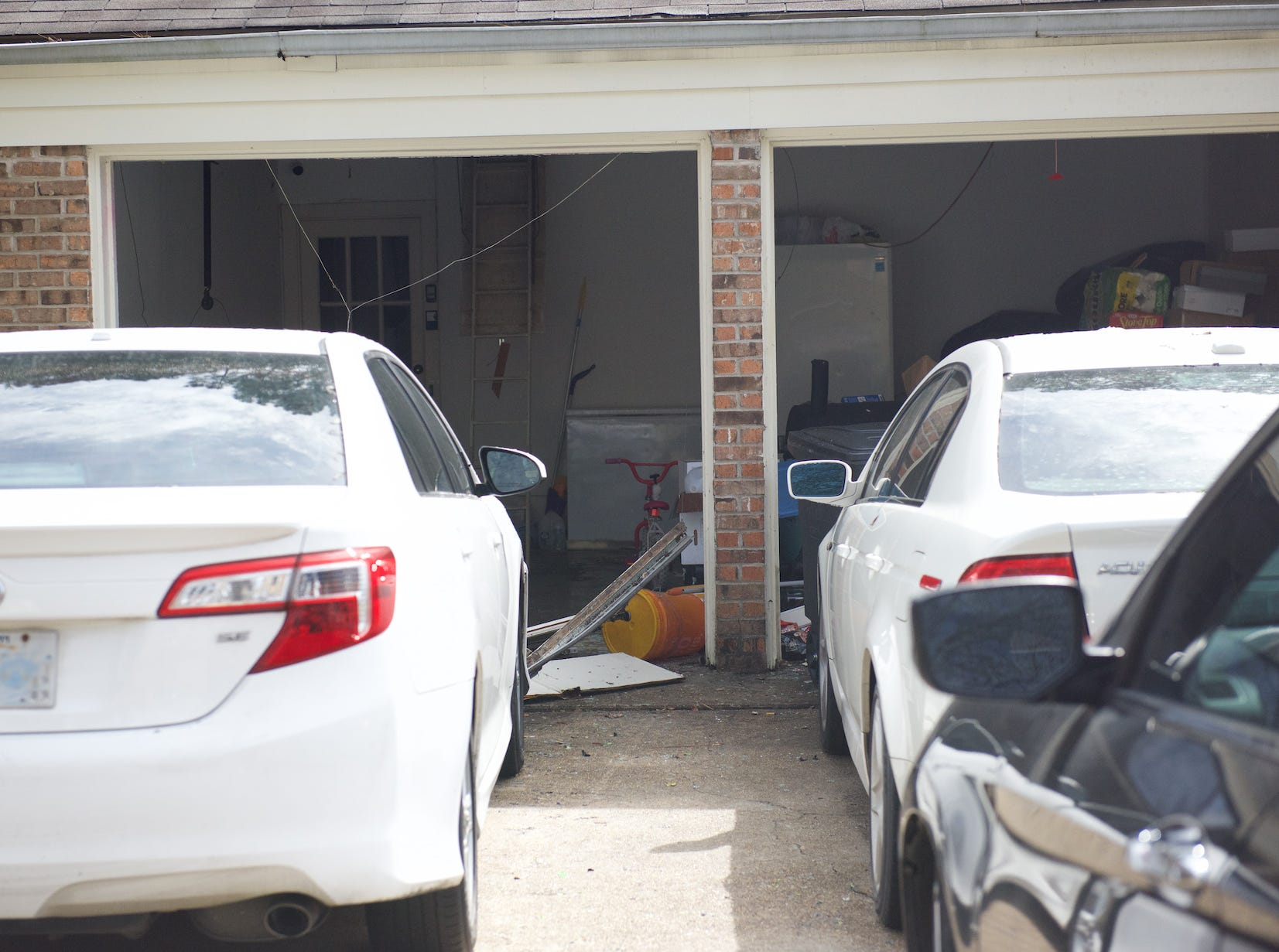 In this photo taken February 18, 2019, law enforcement blew out the garage doors of a Clinton home with detonator's to gain access to the house during a standoff on Saturday, Feb.16, neighbors said.