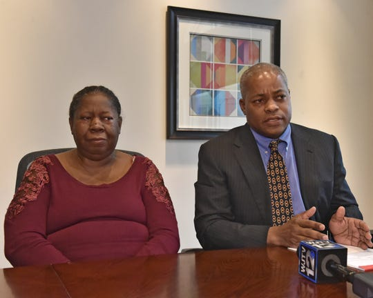 Betty Hill, left, mother of Harvey Hill, and Derek Sells of The Cochran Firm sit at a conference table during a press conference, Tuesday, Feb. 19, 2019, in Ridgeland, Miss. The family of Harvey Hill announced the filing of a wrongful death lawsuit in Hill's death in 2018 in the Madison County jail.