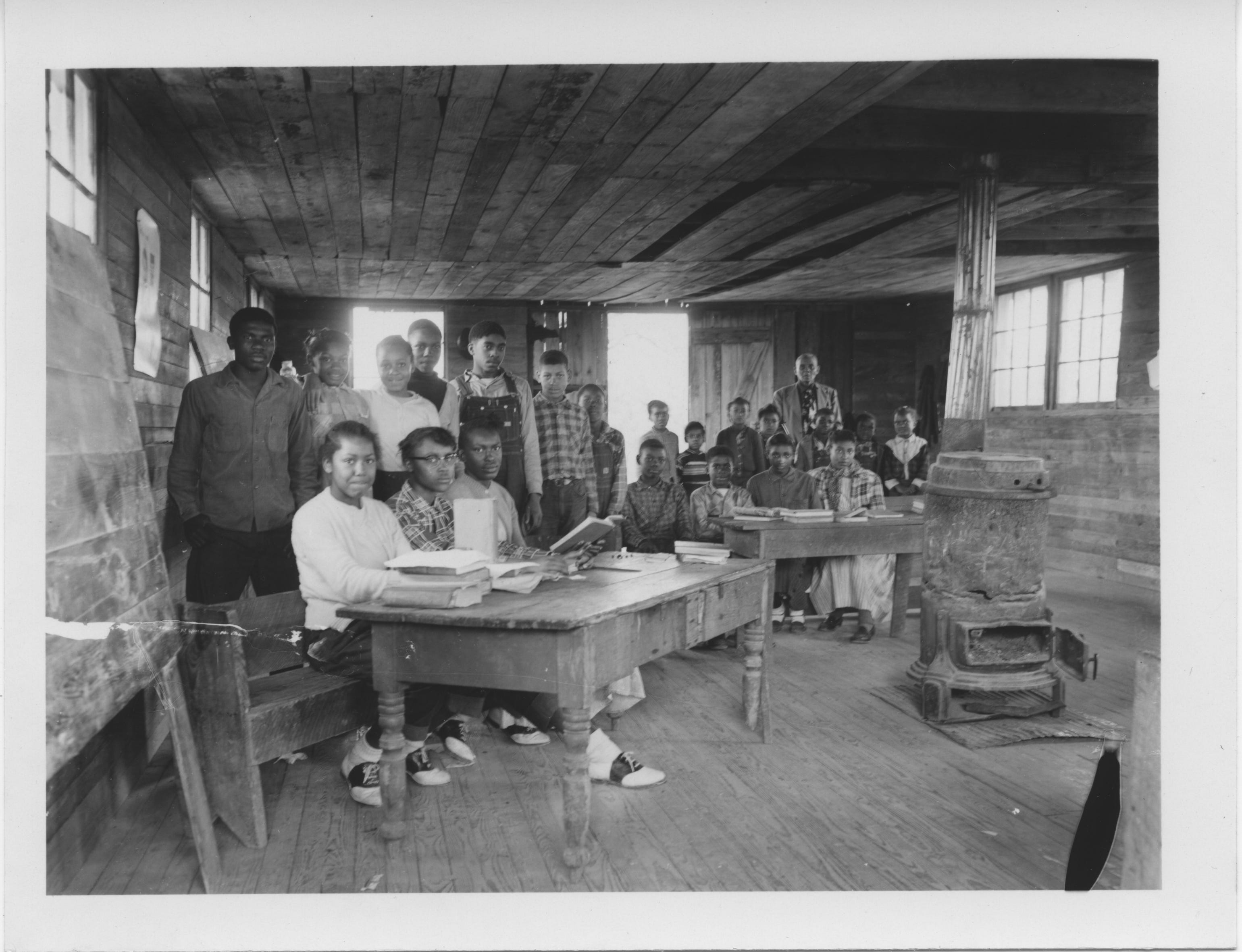 Inside the Pilgrim Rest School in Enid, Mississippi, where a wood stove was the only heat for Black students in 1955.