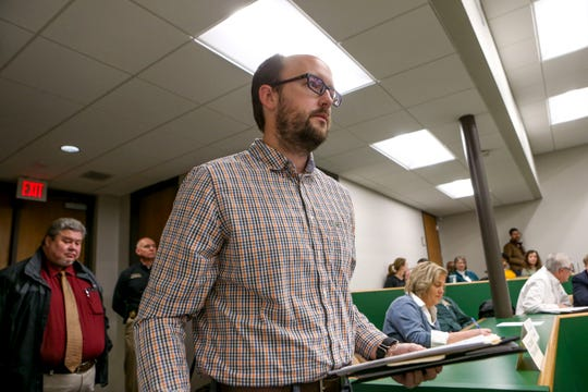 Kyle Dempsey, an assistant psychology professor at UT Martin, walks up to the floor to present the plan for a historical marker for lynchings during a county commission meeting at West TN AgResearch Center in Jackson, Tenn., on Tuesday, Feb. 19, 2019.