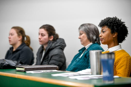 Melanie Taylor, a City Fellowship minister, listens to ongoing discourse during a county commission meeting at West TN AgResearch Center in Jackson, Tenn., on Tuesday, Feb. 19, 2019.