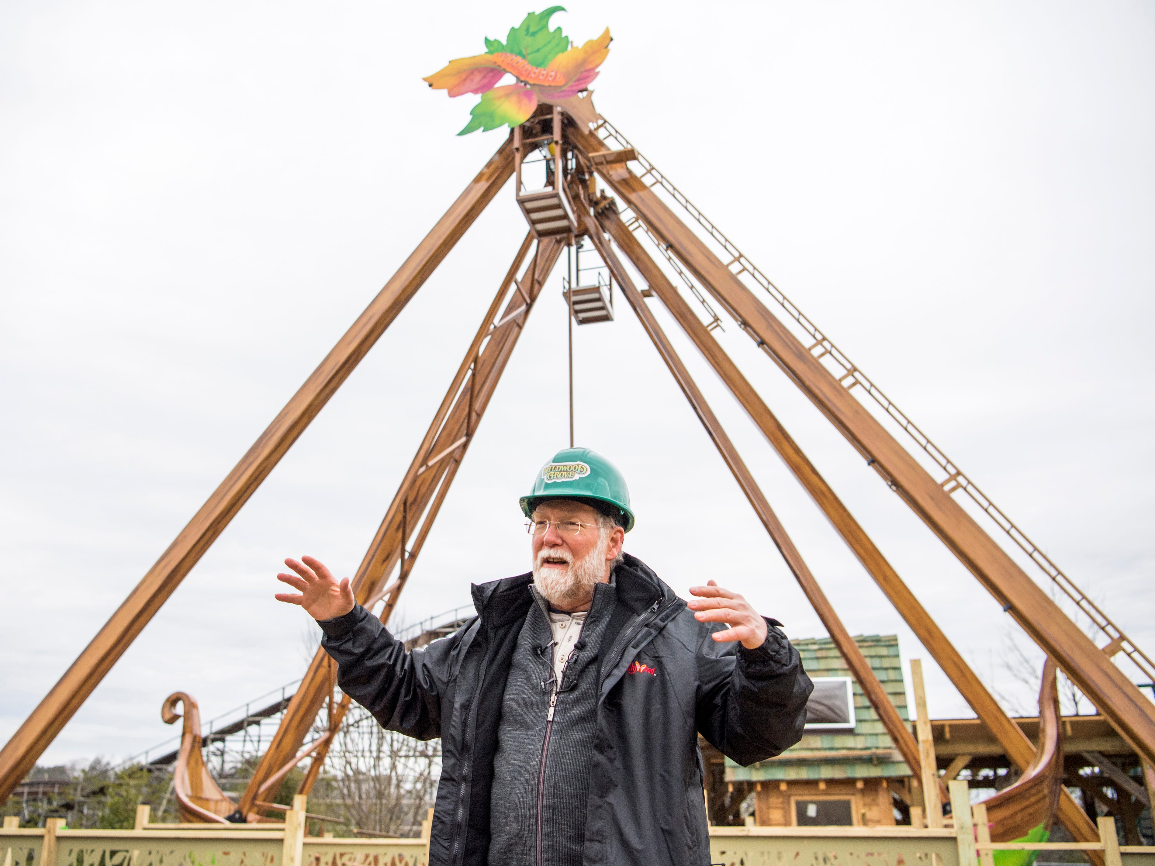 Patrick Brennan, art director for Dollywood's new Wildwood Grove area, points out features on the Giant Tree Swing ride during a construction site tour on Tuesday, February 19, 2019.