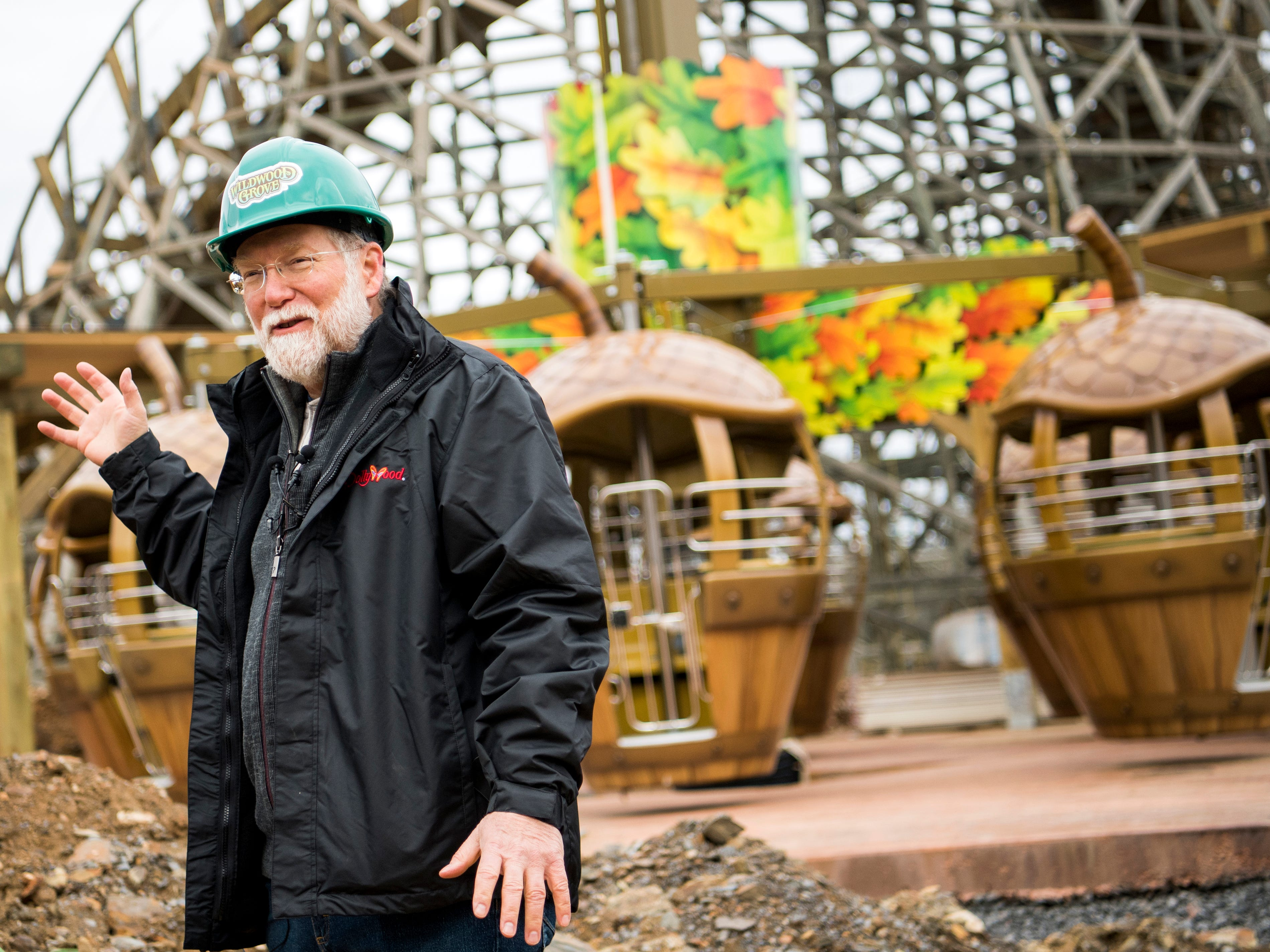 Patrick Brennan, art director for Dollywood's new Wildwood Grove area, points out features on the Treetop Tower ride during a construction site tour on Tuesday, February 19, 2019.