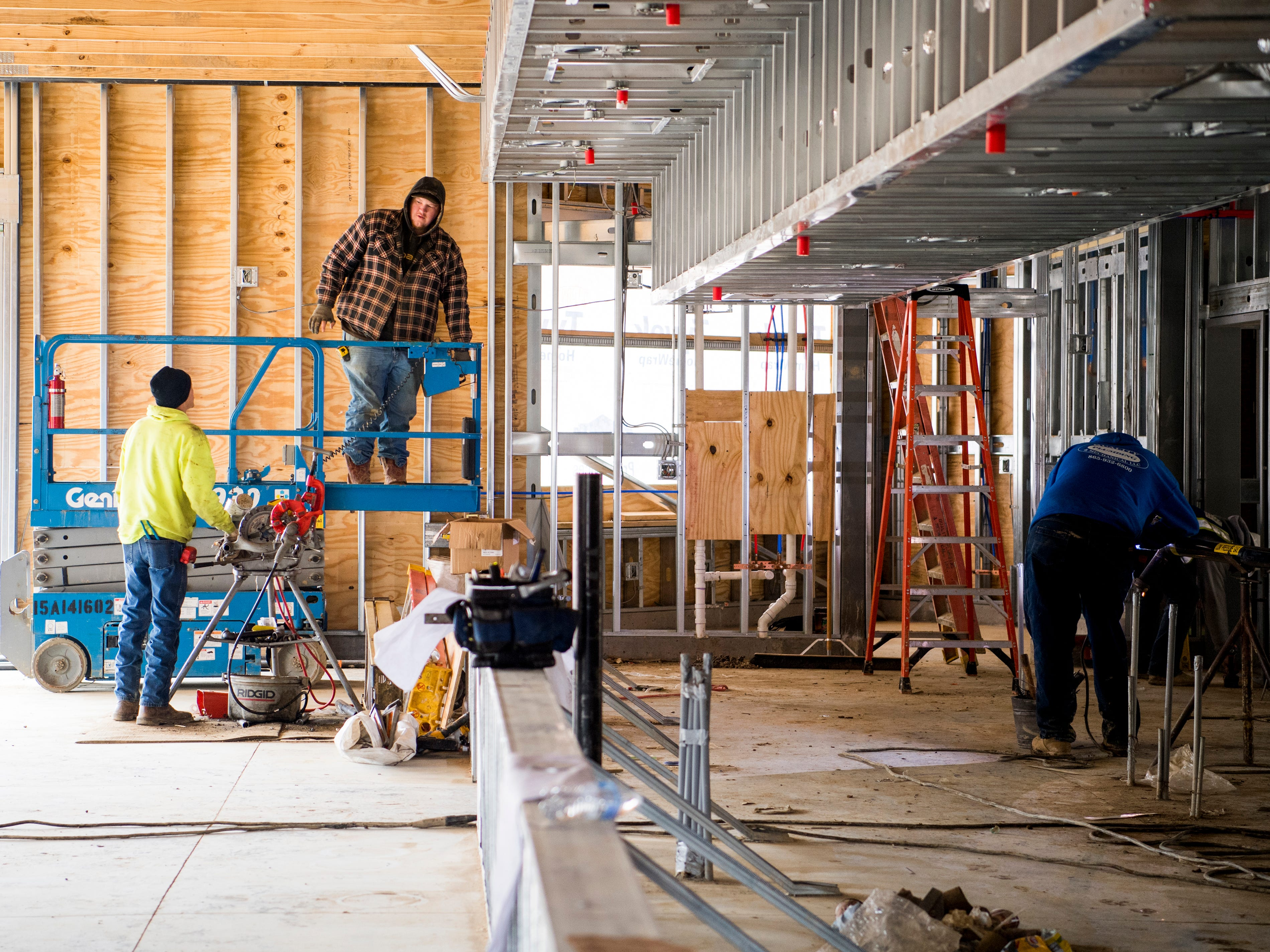 Construction workers continue work in a dining area in Dollywood's new Wildwood Grove area of the park on Tuesday, February 19, 2019.