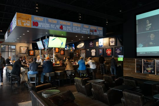 Fieldhouse Social features several flat screens and leather recliners.