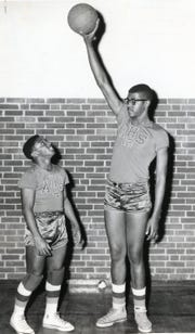 "Austin High teammates John Dean, left, and Paul Hogue, December, 1957. Hogue, the 6' 10"" star at Austin High went to the University of Cinncinnati on an athletic scholarship."