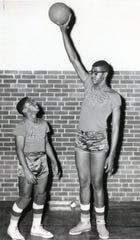 "Austin High teammates John Dean, left, and Paul Hogue, December, 1957. Hogue, the 6' 10"" star at Austin High went to the University of Cinncinnati on an athletic scholarship."