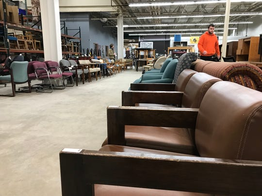 Staff at Purdue University Surplus Store, 700 Ahlers Drive, West Lafayette, sets out more than 200 chairs, all priced at $1, in a Bobby Knight-themed sale timed for Tuesday's Purdue-IU game in Bloomington. During a Purdue-IU game in 1985, Knight threw a chair across the floor at Assembly Hall to protest officiating.