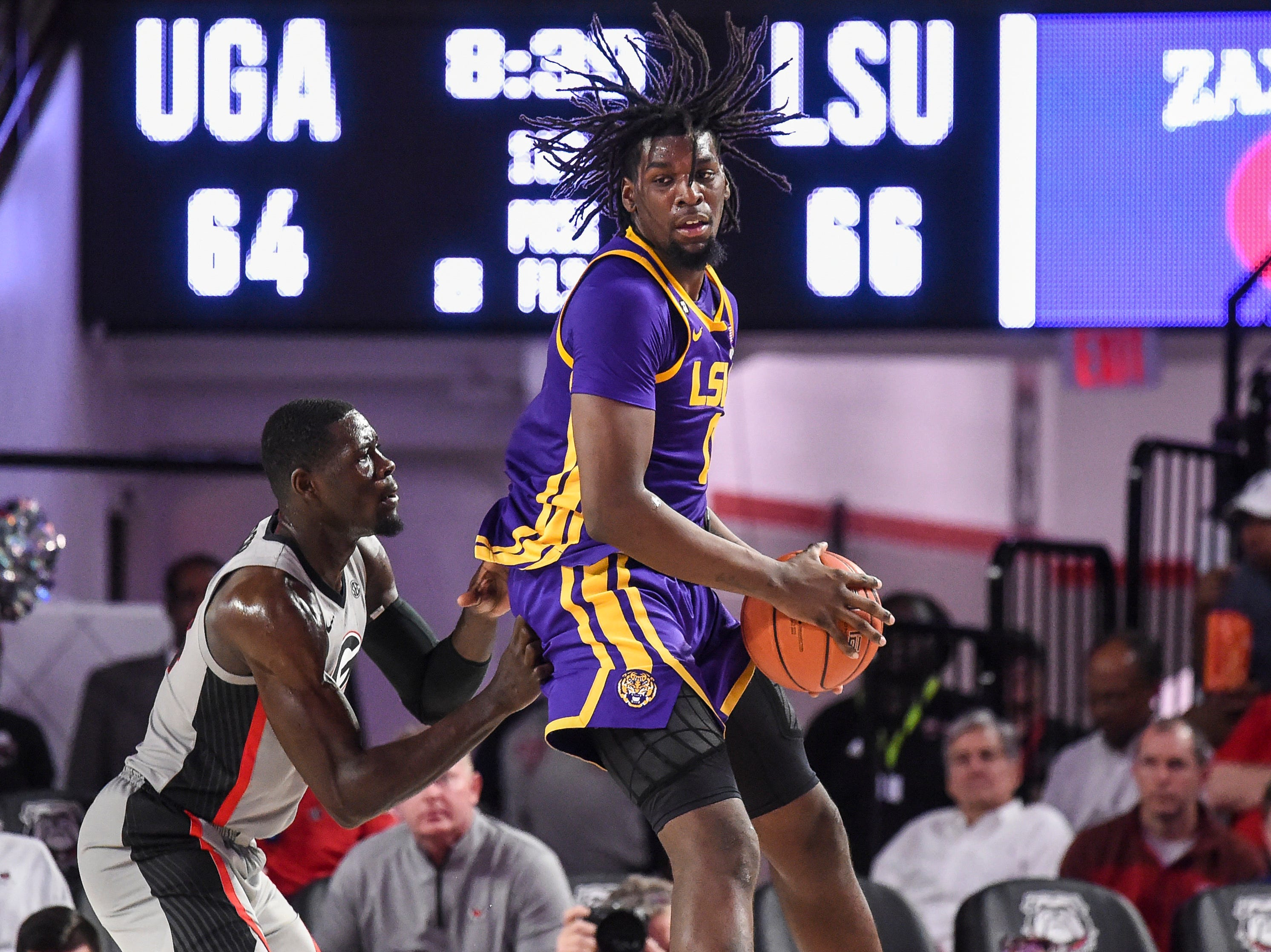 Feb 16, 2019; Athens, GA, USA; LSU Tigers forward Naz Reid (0) controls a rebound against Georgia Bulldogs forward Derek Ogbeide (34) during the second half at Stegeman Coliseum. Mandatory Credit: Dale Zanine-USA TODAY Sports