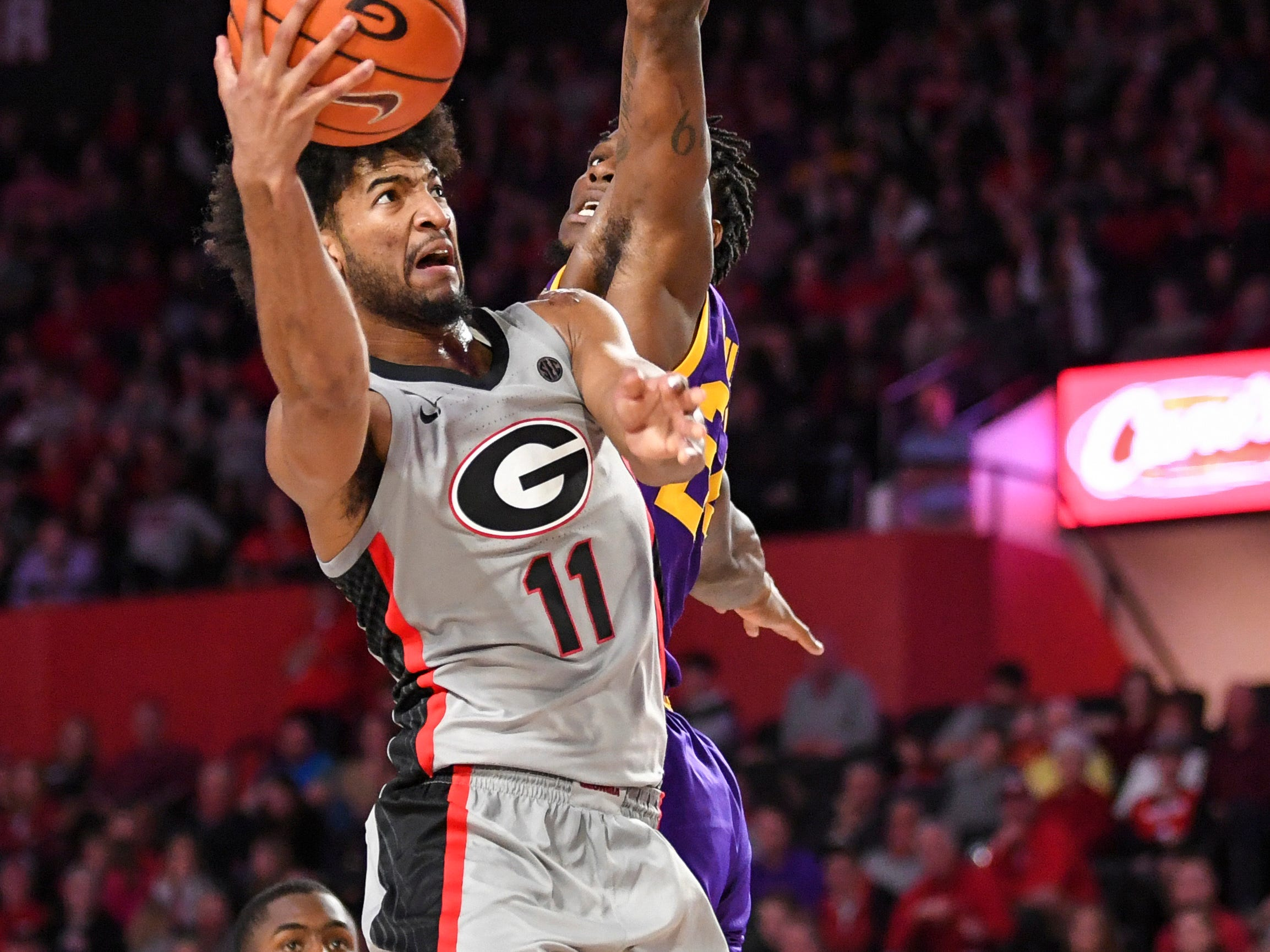 Feb 16, 2019; Athens, GA, USA; Georgia Bulldogs guard Christian Harrison (11) shoots against LSU Tigers forward Emmitt Williams (24) during the second half at Stegeman Coliseum. Mandatory Credit: Dale Zanine-USA TODAY Sports