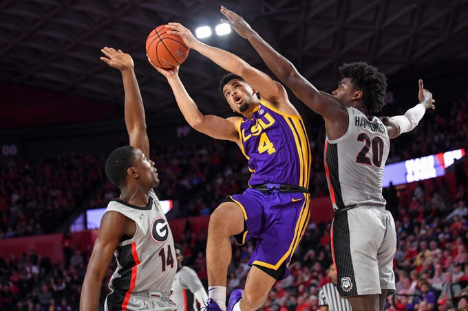 Feb 16, 2019; Athens, GA, USA; LSU Tigers guard Skylar Mays (4) tries to get to the basket between Georgia Bulldogs guard Tye Fagan (14) and forward Rayshaun Hammonds (20) during the first half at Stegeman Coliseum. Mandatory Credit: Dale Zanine-USA TODAY Sports