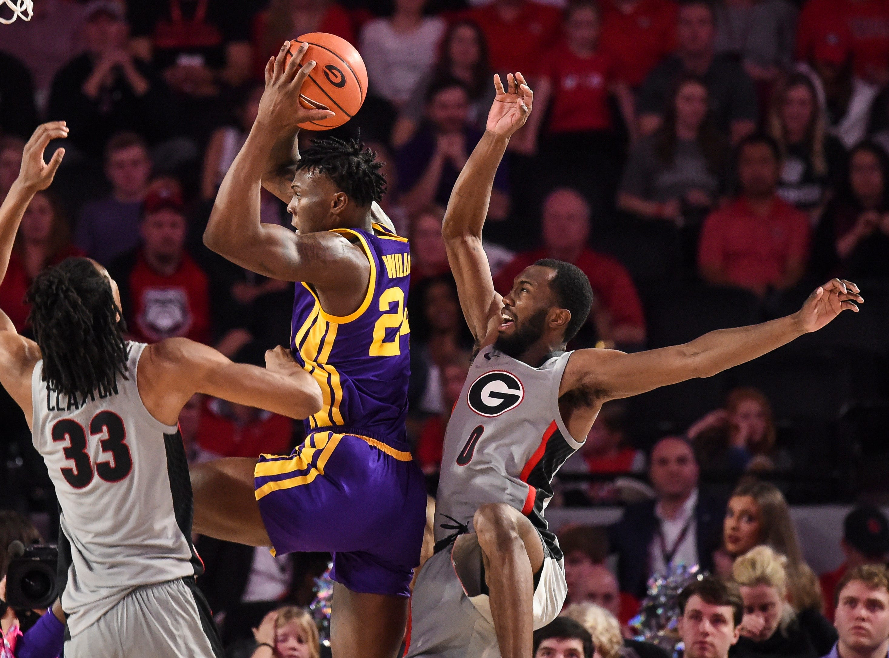 Feb 16, 2019; Athens, GA, USA; LSU Tigers forward Emmitt Williams (24) controls the ball between Georgia Bulldogs forward Nicolas Claxton (33) and guard William Jackson II (0) during the second half at Stegeman Coliseum. Mandatory Credit: Dale Zanine-USA TODAY Sports