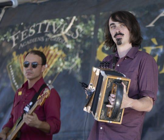 Feufollet performs Sunday at Vermilionville during the Courir de Mardi Gras celebration.