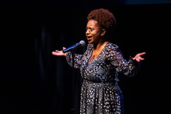 """Tina Burkhalter tells her story about being single, and a wild dating adventure, at the Lafayette Storytellers Project """"Romance ... or not"""" event on Monday, February 18, 2019."""