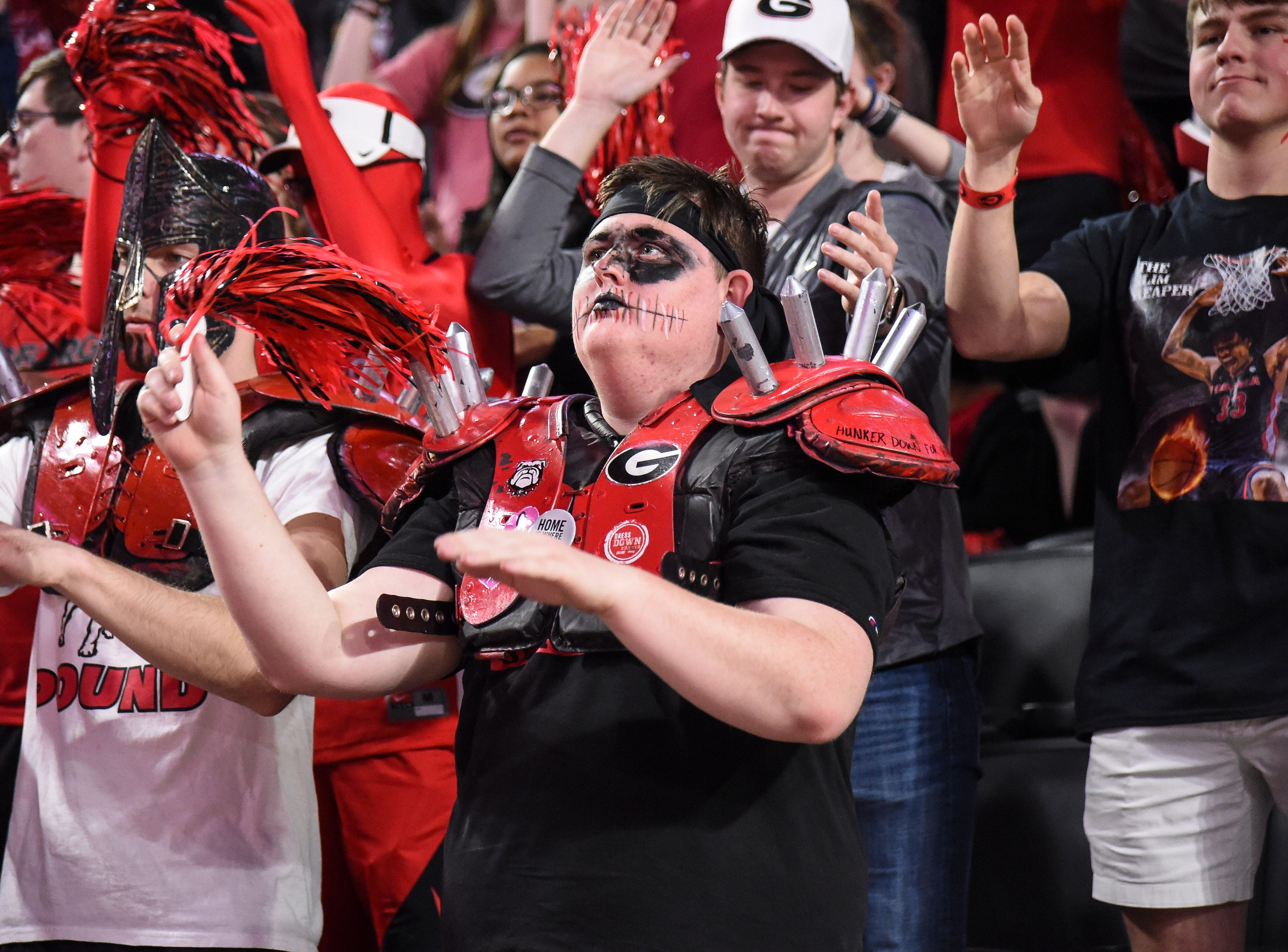 Feb 16, 2019; Athens, GA, USA; Georgia Bulldogs fans cheer for their team against the LSU Tigers during the first half at Stegeman Coliseum. Mandatory Credit: Dale Zanine-USA TODAY Sports