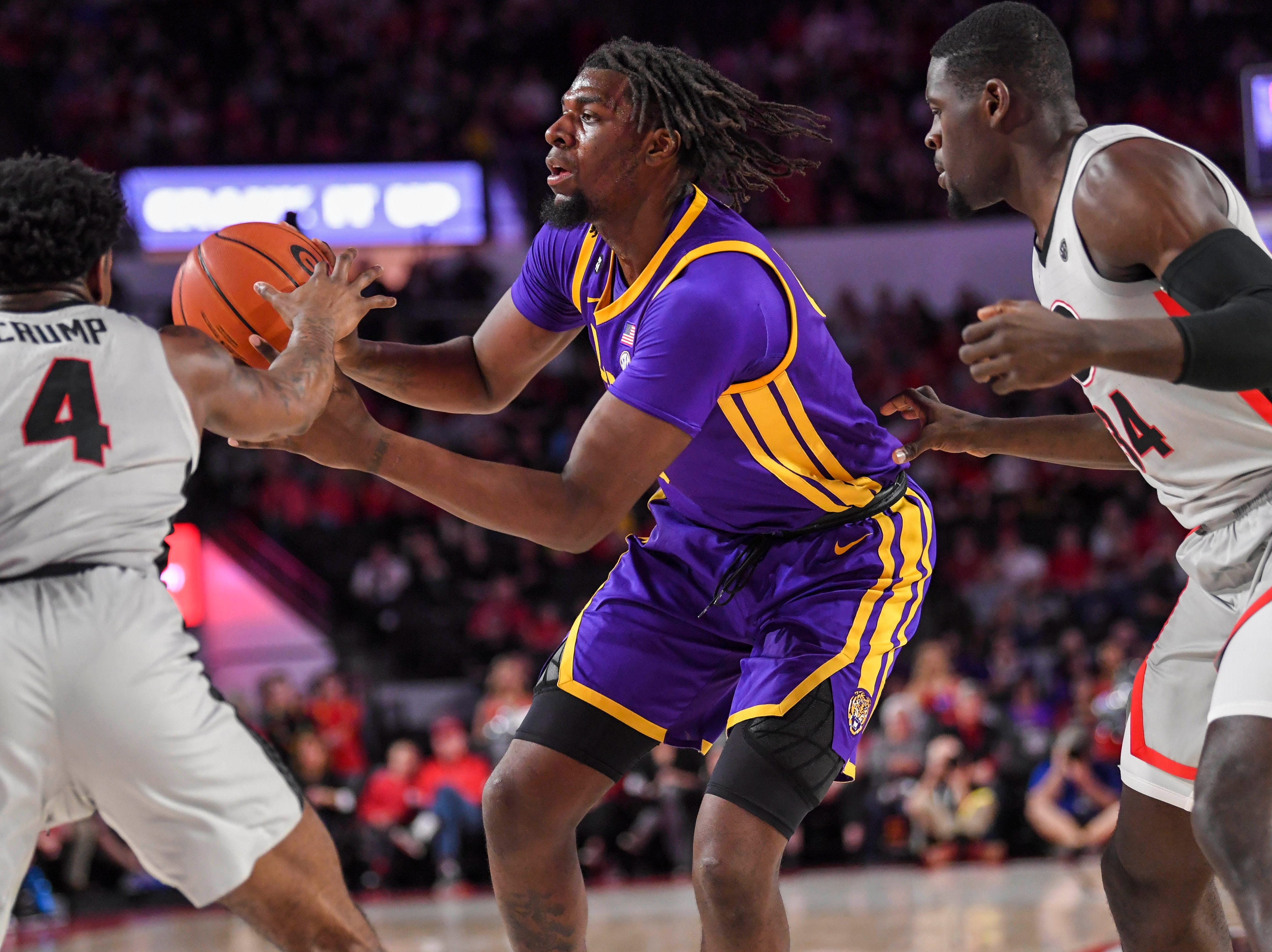 Feb 16, 2019; Athens, GA, USA; LSU Tigers forward Naz Reid (0) passes the ball against Georgia Bulldogs guard Tyree Crump (4) during the first half at Stegeman Coliseum. Mandatory Credit: Dale Zanine-USA TODAY Sports