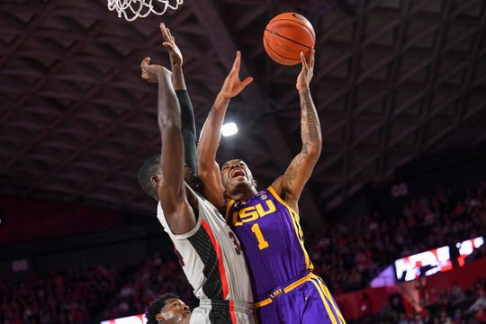Feb 16, 2019; Athens, GA, USA; LSU Tigers guard Ja'vonte Smart (1) shoots over Georgia Bulldogs forward Derek Ogbeide (34) during the first half at Stegeman Coliseum. Mandatory Credit: Dale Zanine-USA TODAY Sports