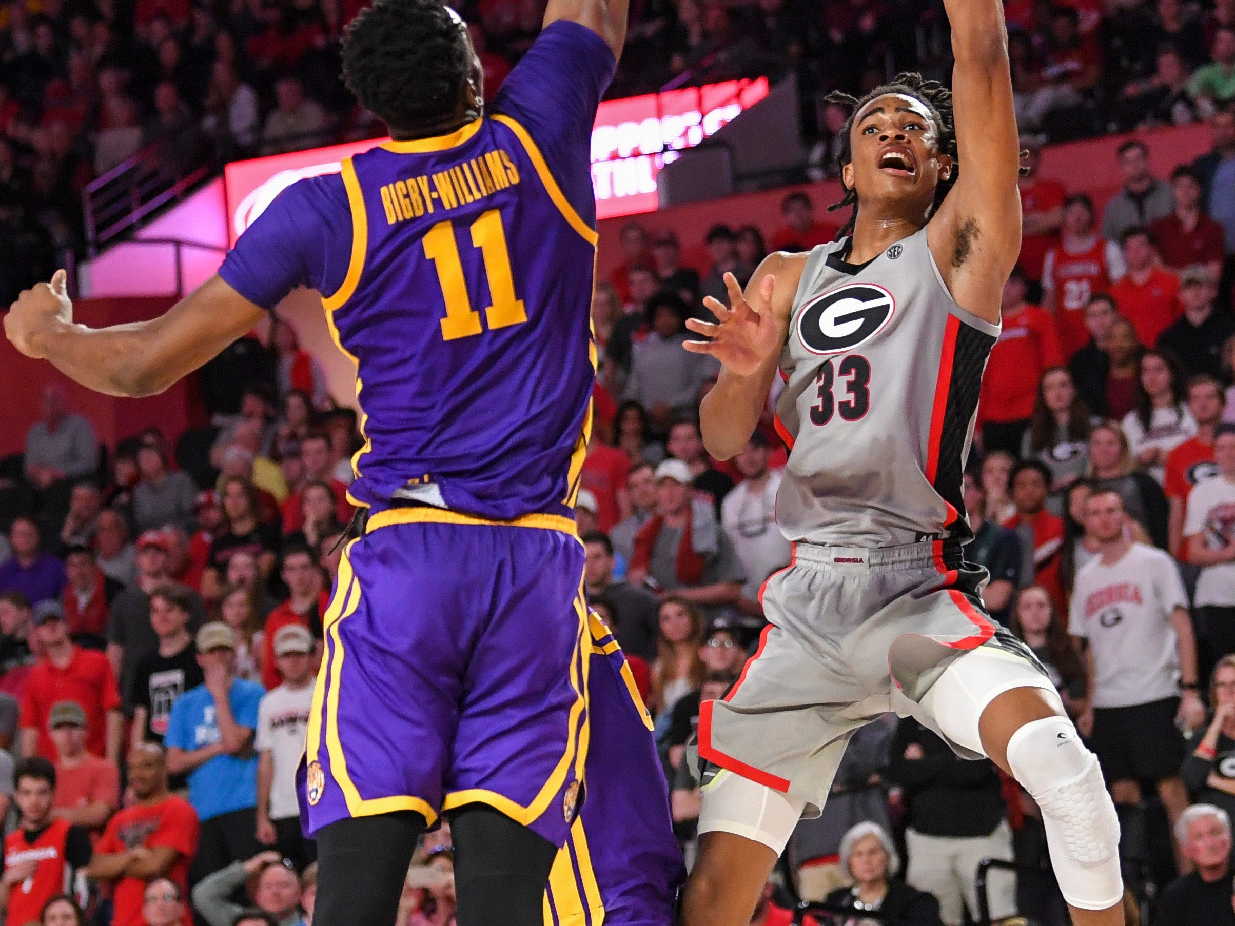 Feb 16, 2019; Athens, GA, USA; Georgia Bulldogs forward Nicolas Claxton (33) shoots over LSU Tigers forward Kavell Bigby-Williams (11) during the second half at Stegeman Coliseum. Mandatory Credit: Dale Zanine-USA TODAY Sports