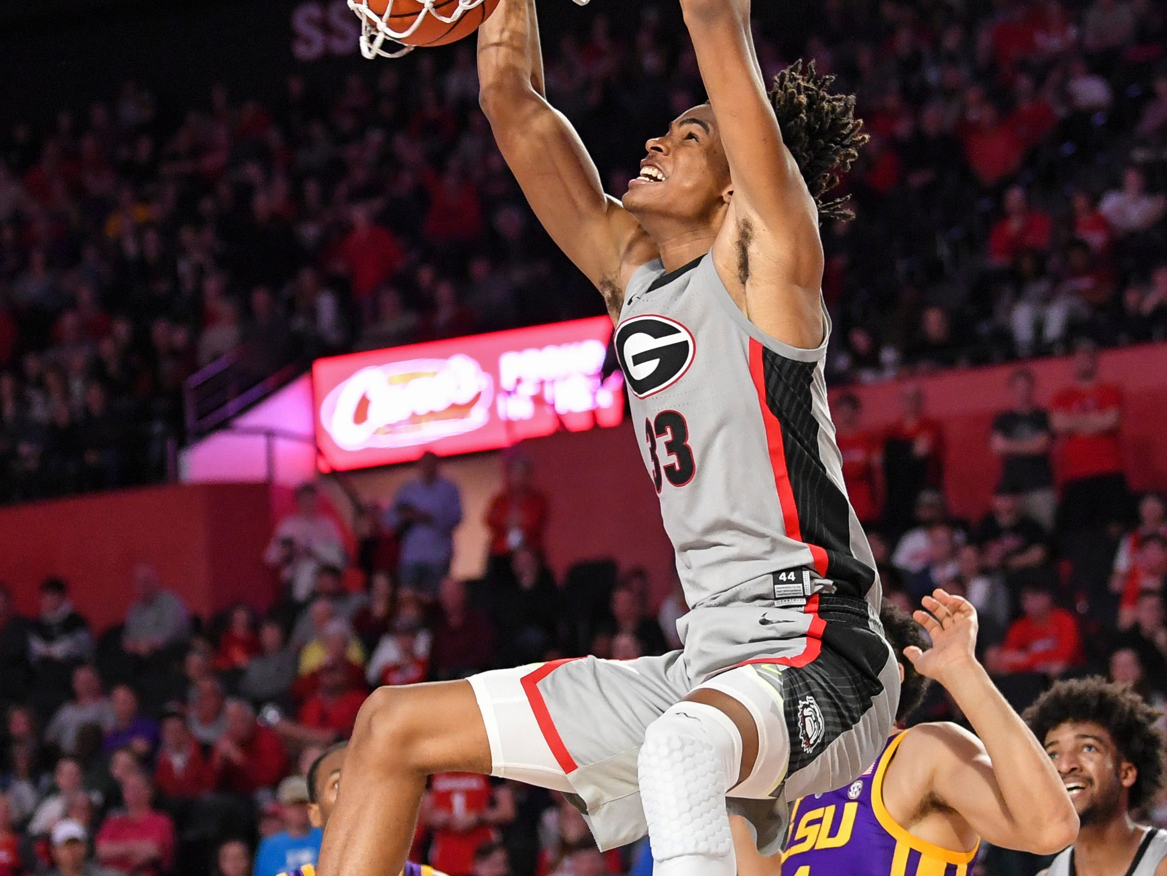 Feb 16, 2019; Athens, GA, USA; Georgia Bulldogs forward Nicolas Claxton (33) dunks against LSU Tigers guard Skylar Mays (4) during the second half at Stegeman Coliseum. Mandatory Credit: Dale Zanine-USA TODAY Sports
