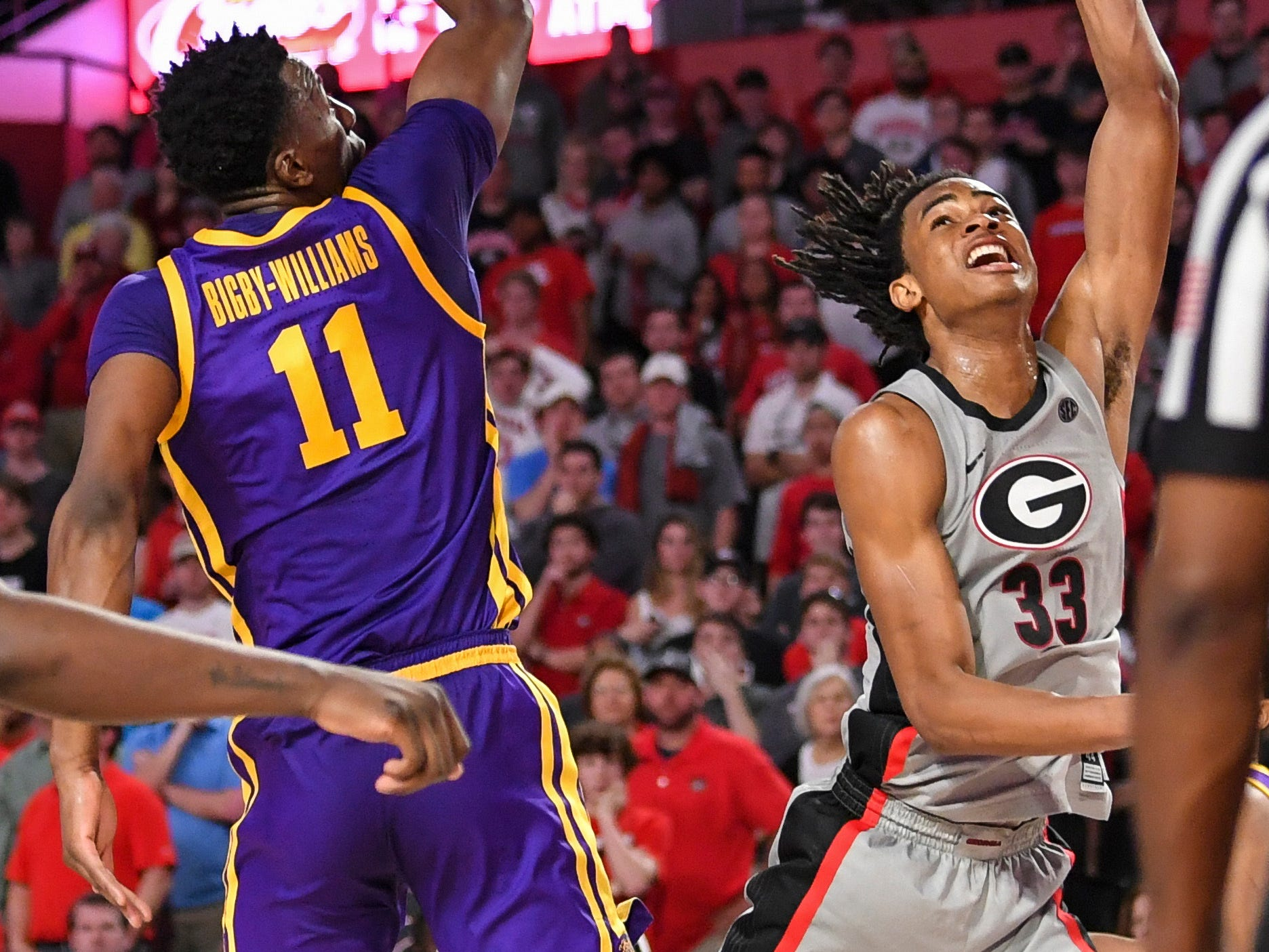 Feb 16, 2019; Athens, GA, USA; Georgia Bulldogs forward Nicolas Claxton (33) shoots against LSU Tigers forward Kavell Bigby-Williams (11) during the second half at Stegeman Coliseum. Mandatory Credit: Dale Zanine-USA TODAY Sports