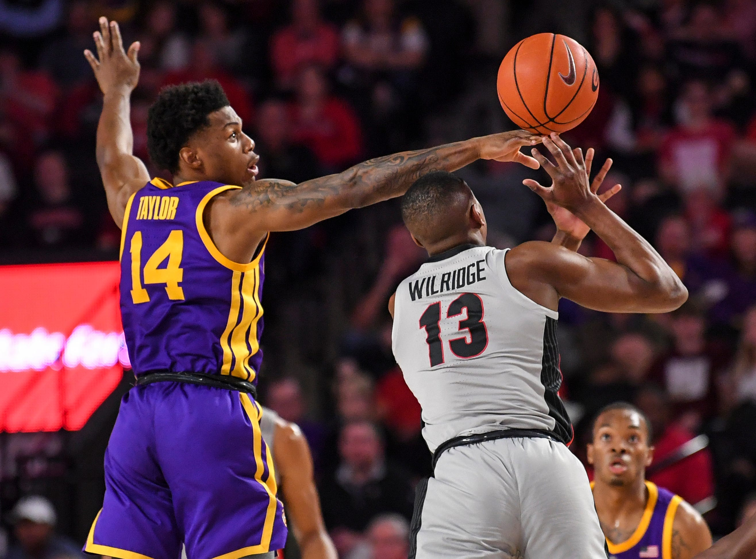 Feb 16, 2019; Athens, GA, USA; Georgia Bulldogs forward E'Torrion Wilridge (13) is fouled by LSU Tigers guard Marlon Taylor (14) during the second half at Stegeman Coliseum. Mandatory Credit: Dale Zanine-USA TODAY Sports