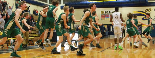 Howell basketball players storm the court after Luke Russo's game-winning 3-pointer in a 58-57 victory at Wayne Memorial on Monday, Feb. 18, 2019.